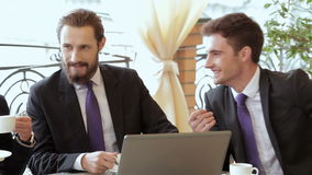 Two businessman meeting for lunch. In coffee shop. Smiling attractive businesswoman and man having discussion. While drinking coffee at lunch break stock footage