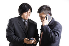 Two businessman meeting and used mobile phone Stock Image