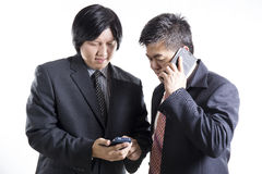 Two businessman meeting and used mobilephone Royalty Free Stock Image
