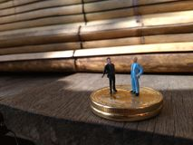 Two businessman mini figure toys, chit chat about bitcoin. Photo two businessman mini figure toys, chit chat about bitcoin stock images