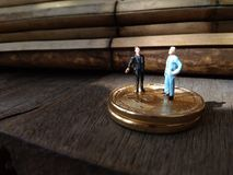 Two businessman mini figure toys, chit chat about bitcoin. Photo two businessman mini figure toys, chit chat about bitcoin stock image