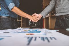 Two businessman people shaking hands with making a deal, Business people shaking hands. stock photography