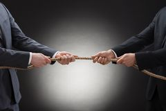 Two businessman pulling rope Royalty Free Stock Photo