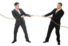 Two businessman pulling rope Stock Photography