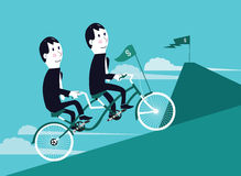 Two businessman riding tandem bicycle to the goal. Royalty Free Stock Photos
