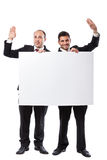 Two Businessman saluting and holding a billboard Royalty Free Stock Image