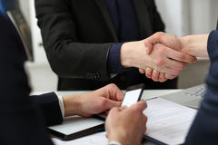 Two businessman shake hands as hello in office closeup Royalty Free Stock Photos
