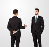 Two businessman shake hands Stock Images