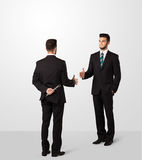 Two businessman shake hands Royalty Free Stock Photography