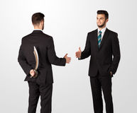 Two businessman shake hands Stock Photos