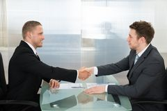 Two businessman shaking each other hands Royalty Free Stock Photo