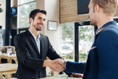Two businessman shaking hands Stock Image