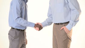Two businessman shaking hands. close-up. Two young businessman. African American businessman and a European shaking hands. close-up stock footage