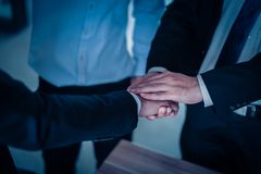 Two businessman shaking hands for demonstrating their agreement to sign agreement or contract between their companies. Success, dealing, greeting and partner stock images