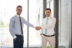 Two Businessman Shaking Hands Greeting Each Other Stock Image