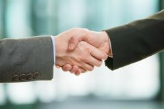 Two businessman shaking hands stock photography
