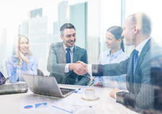 Two businessman shaking hands in office Royalty Free Stock Images