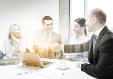 Two businessman shaking hands in office Royalty Free Stock Photo