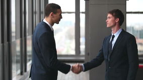 Two businessman shaking hands. Profile of two businessman shaking hands stock footage