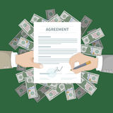 Two businessman signing an agreement. Successful financial partnership, teamwork concept. Hand holds the form of document. On a pile of money. Conclusion of a Royalty Free Stock Image