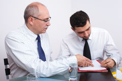 Two businessman sitting at table during meeting Royalty Free Stock Image