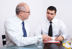 Two businessman sitting at table during meeting Royalty Free Stock Photo