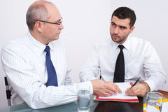 Two businessman sitting at table during meeting Stock Image