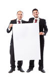 Two Businessman smiling and holding a billboard Royalty Free Stock Images
