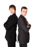 Two businessman standing back to back Royalty Free Stock Images