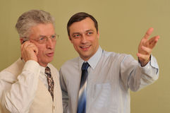 Two businessman standing next Stock Images