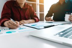 Two businessman team calculate about summary report annual on ta. Ble office royalty free stock images