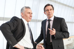 Two businessman thinking Royalty Free Stock Photo
