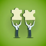 Two businessman trying to combine puzzle pieces. EPS 10 file Royalty Free Stock Images