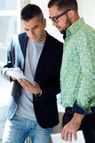 Two businessman using digital tablet in office. Royalty Free Stock Photo