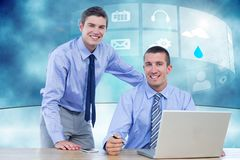 Two businessman using laptop in their office Royalty Free Stock Images