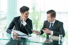 Two businessman using tablet during meeting Stock Images