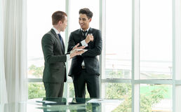 Two businessman using tablet during meeting Stock Photography