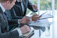 Two businessman using tablet stock photography