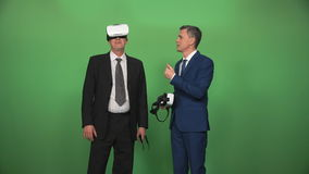 Two businessman using VR headsets. The partners using the virtual reality headsets for 3D simulator stock video footage
