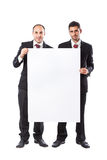 Two Businessman and a vertical billboard Royalty Free Stock Photography