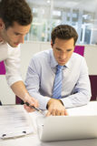 Two businessman work in office on laptop Stock Photography