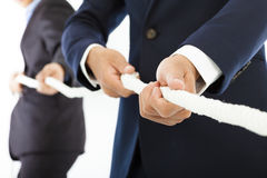 Two businessman work together and playing tug of war Royalty Free Stock Photos