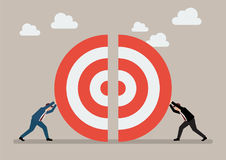 Two businessmans pushing a pieces of big target together Royalty Free Stock Photography