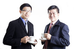 Two Businessmans talking and drink the coffee Stock Photos