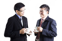 Two Businessmans talking and drink the coffee Royalty Free Stock Photos