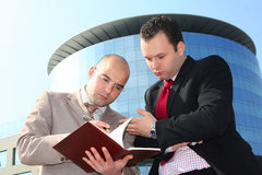 Two businessmen. In the middle of conversation about job Royalty Free Stock Image