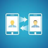 Two businessmen. Communicatitng with the mobile phones Royalty Free Stock Images