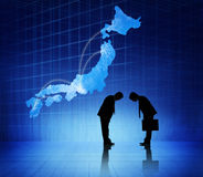 Two Businessmen Bowing Heads To Each Other And A Japan Cartograp Royalty Free Stock Photo