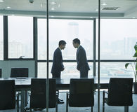 Two Businessmen Bowing to Each Other Royalty Free Stock Photography