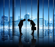Two Businessmen Bowing Royalty Free Stock Photo
